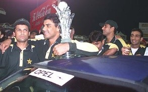 Waqar Younis and Moin Khan stand proudly near the car that Waqar walked away with at Sharjah, Pakistan v South Africa, Coca-Cola Cup 1999/00, Final, Sharjah C.A. Stadium, 31 March 2000. ©ESPNcricinfo Ltd